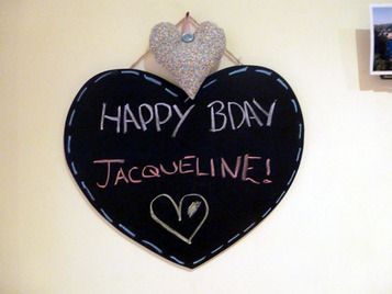 Picture of a heart shaped black board saying HAppy Birthday Jacqueline