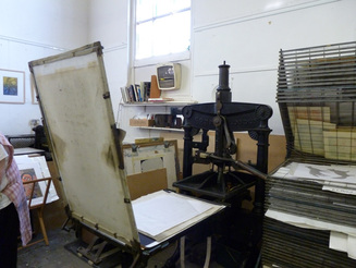 Picture of a print press dating back to the 1800s
